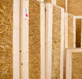 Fire protection of straw-insulated panels