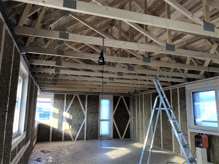 Roof trusses supported by the wall panels and ring beam