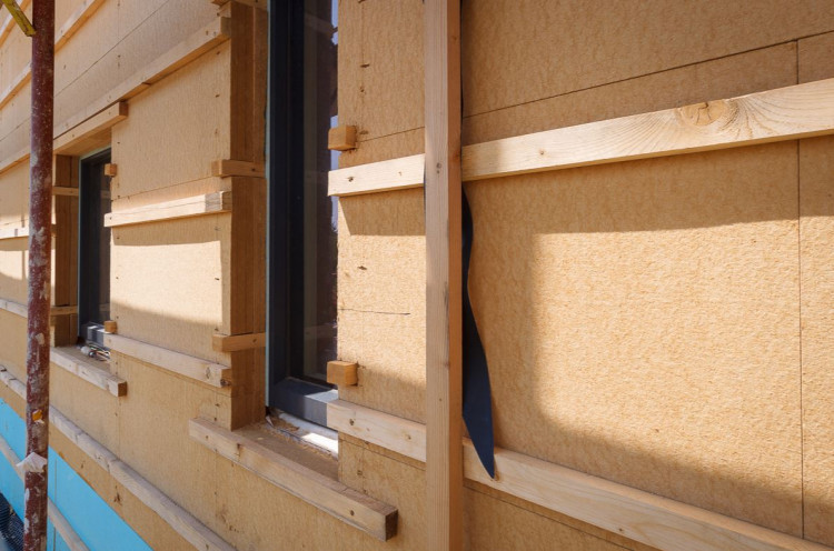Exterior wall with wood fibre boards installed.